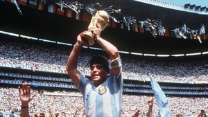 Diego Maradona holds the famous trophy aloft