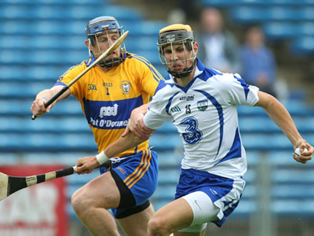 Maurice Shanahan of Waterford with Clare's Conor Cooney in close attention