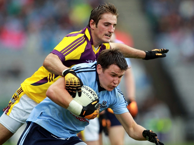 Niall Corkery of Dublin shields the ball from Wexford's Brian Malone