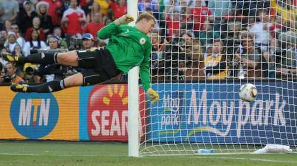 German goalkeeper Manuel Neuer watches Frank Lampard's shot bounce over the line for the England goal that never was
