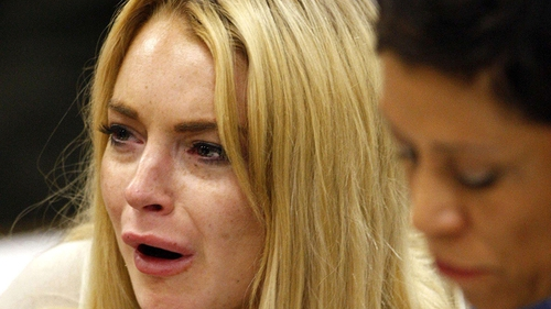 Lohan (with her attorney Shawn Chapman Holley) - Broke down after hearing sentence