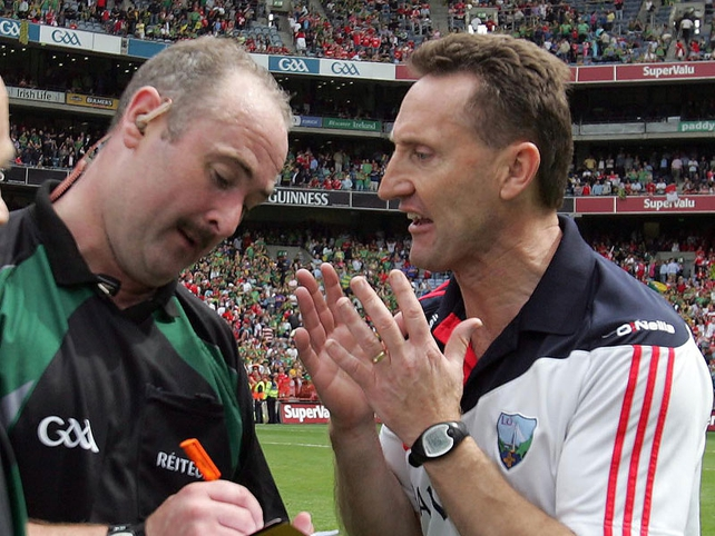 Louth manager Peter Fitzpatrick pleads with referee Martin Sludden