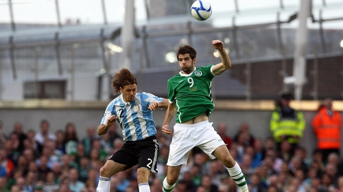 Ireland international Cillian Sheridan helped APOEL through to the final qualifier on the night that his former club Celtic crashed out 6-1 to Legia Warsaw