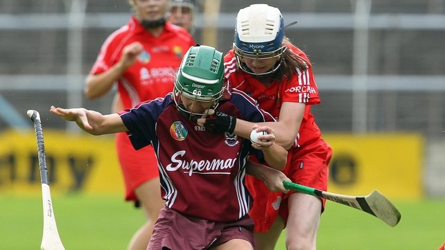 Galway's Orla Kilkenny is flattened by Katriona Mackey of Cork