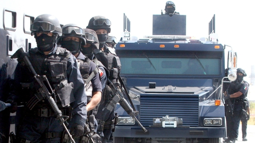 Mexico - Heavily armed police officers patrolling northeastern areas