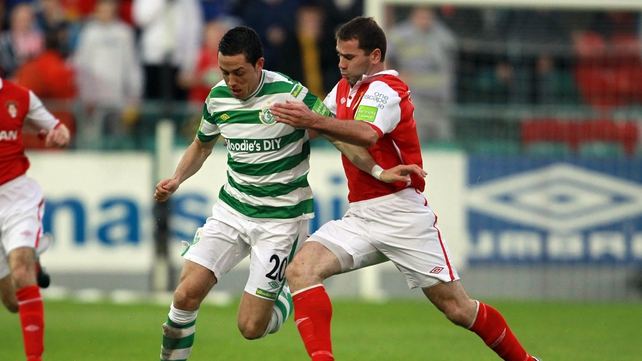 Dave Mulchay of St Pat's Athletic and Billy Dennehy of Shamrock Rovers battle for possession at Richmond Park