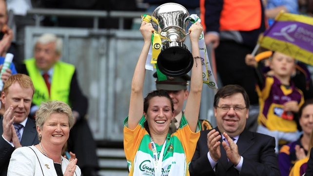 Offaly captain Michaela Morkan lifts the Jack McGrath cup following the win over Wexford