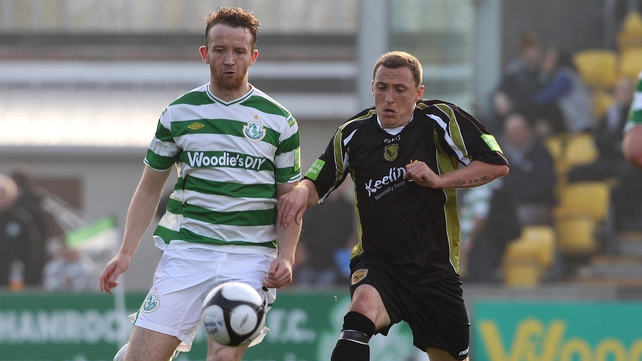 Shamrock Rovers' Aidan Price and Gary O'Neill of Sporting Fingal have their eyes on the ball at Tallaght Stadium