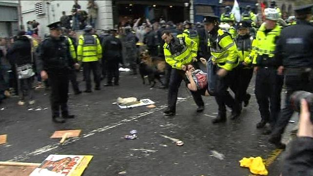 Dublin - Protestor taken away by gardaí