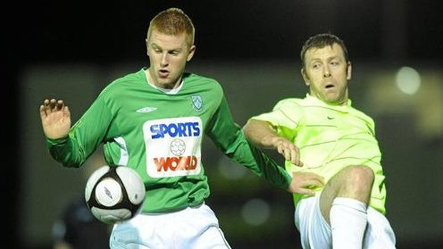 Shane O'Connor of Bray Wanderers (left) & Monaghan United's Dom Tierney battle for possession at Gortakeegan