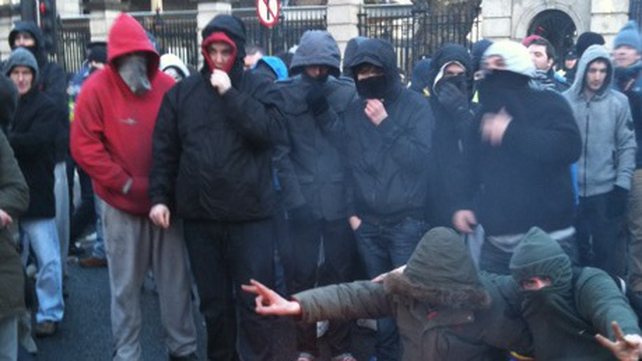 Leinster House - Masked protestors outside Dáil