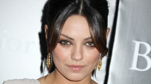 Kunis goes to the ball