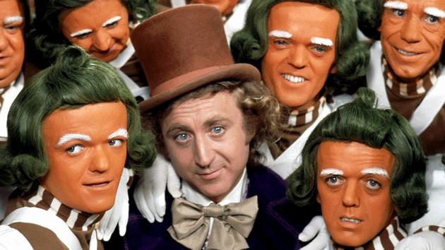 Gene Wilder as Wonka, surrounded by his beloved Oompa-Loompas