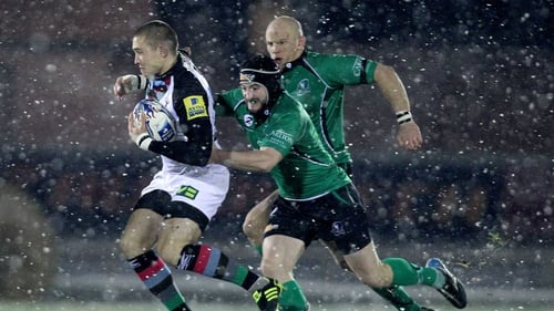 Harlequins' Mike Brown is pursued by John Muldoon and Keith Matthews at a snowy Sportsground