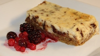 Baked Toblerone Cheesecake with Winterberry Compote - To serve, cut a rectangle from the cheesecake and serve on a plate with the winterberry compote.
