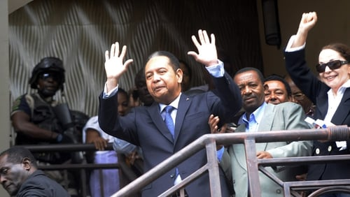 'Baby Doc' Duvalier - Waved to supporters as he was led away