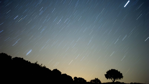 Astronomy - A meteor streaks across the sky during a meteorite shower in Spain