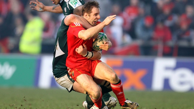 Tomás O'Leary is tackled by Matt Garvey at Thomond Park
