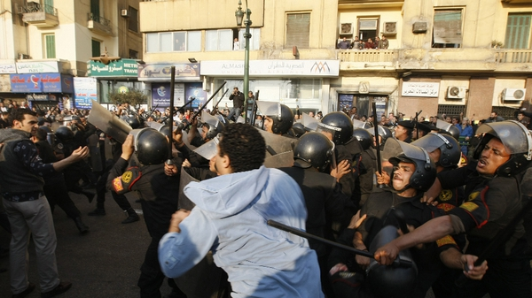 Cairo - Police and demonstrators clashed in a central square