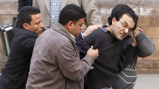 Cairo - Plain clothes officers arrested protestors