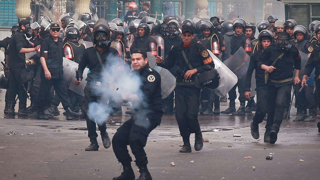 Egypt - Riot police fire tear gas at protestors