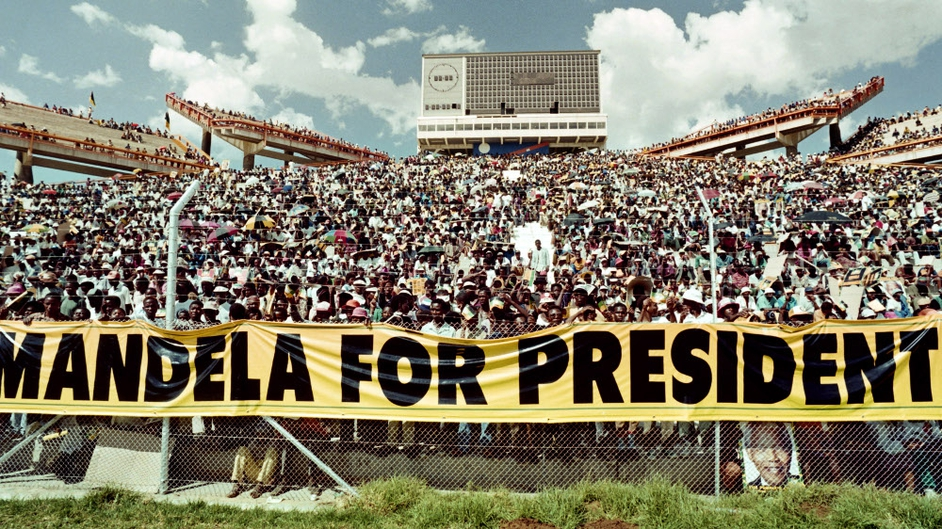 A crowd of 40,000 ANC supporters listen to the address of ANC President Nelson Mandela during a mass rally in Mmabatho in March 1994, ahead of the April general election