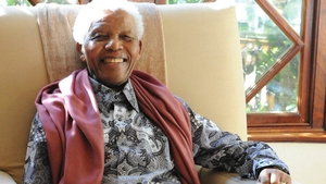 Nelson Mandela relaxes a few minutes before the start of his 92nd birthday celebrations at his home in Johannesburg on 18 July 2010