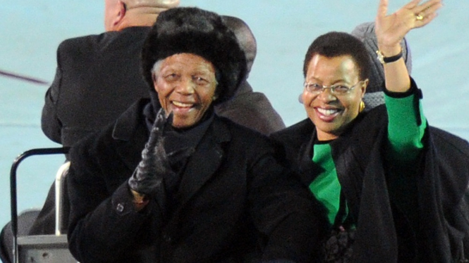 Nelson Mandela and his wife Graca Machel appear and wave to fans from the field before the 2010 football World Cup final between the Netherlands and Spain at Soccer City stadium in Soweto