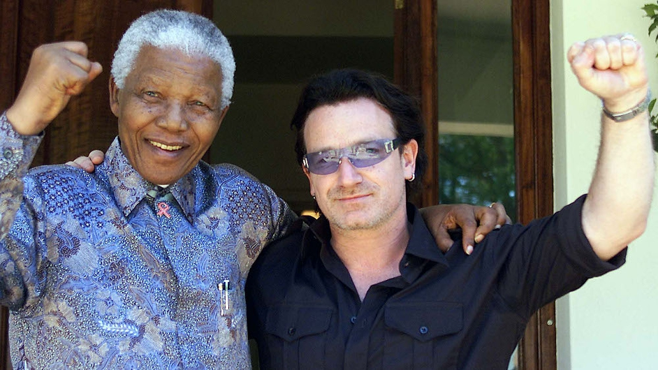 Bono and Nelson Mandela pictured after meeting at Mandela's home in Johannesburg on 25 May 2002