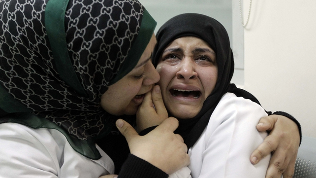 Bahrain - A doctor is comforted at a hospital where protestors were brought
