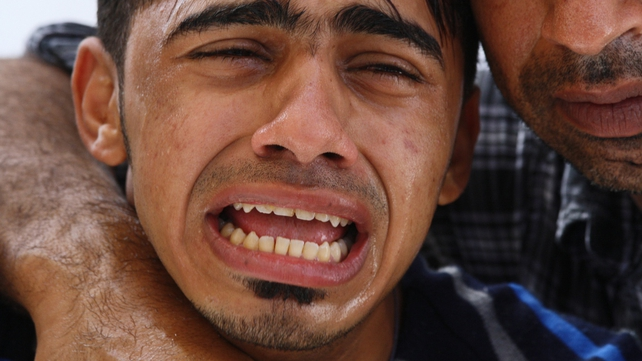 Bahrain - A family member cries at a funeral of an anti-government protestor