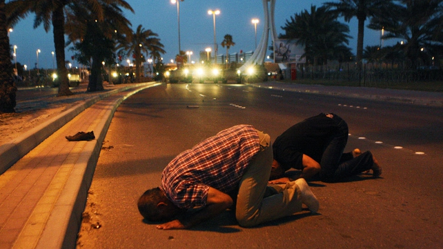 Bahrain - Protestors pray during a clash with security forces near Pearl roundabout