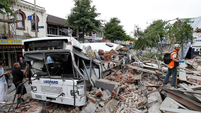 bus crushed by masonry, Christchurch, Aotearoa/New Zealand (22 Feb. 2011)