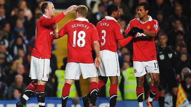 Wayne Rooney celebrated with team-mates after scoring t