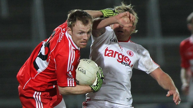 Derry's Martin Donaghy battles Tyrone's Owen Mulligan