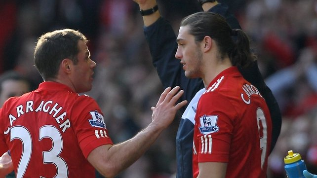 Andy Carroll (r) gets some advice from Jamie Carragher as he comes on for his first Liverpool appearance