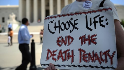 US - An anti-death penalty activist passes out pamphlets during a rally outside the US Supreme Court in 2009