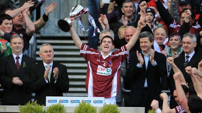 Clarinbridge captain Paul Callanan lifts the Tommy Moore Cup aloft