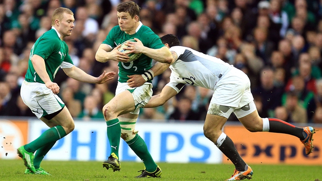 Brian O'Driscoll is tackled by Shontayne Hape...