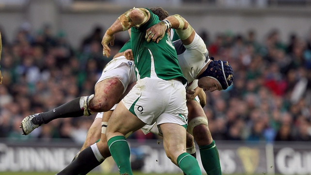 Cian Healy gets to work with a big hit on James Haskall