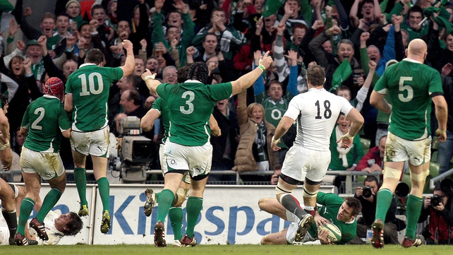 The Irish players celebrate Bowe's try...