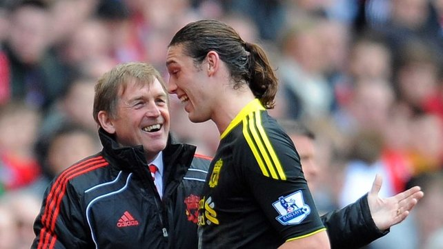 Kenny Dalglish shares a joke with new striker Andy Carroll as he is taken off during Sunday's victory