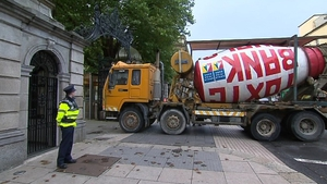 Joe McNamara, acquitted of criminal damage for driving a cement lorry towards the gates of the Dáil made a settlement of €10,000 with the revenue