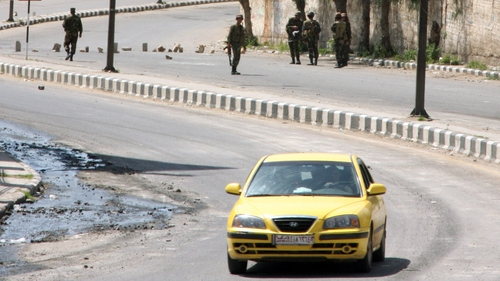 Syria - Security forces man a checkpoint outside Daraa