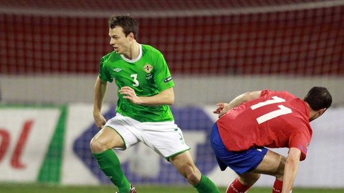 Jonny Evans will miss Northern Ireland's World Cup qualifier with Azerbaijan