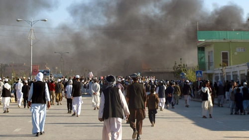 Smoke billows from the UN headquarters after protesters attacked the compound in Mazar-i-Sharif