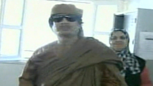 Muammar Gaddafi - Looked relaxed and confident during visit to school