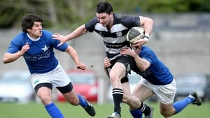 Final for Donnybrook - St Mary's Ian McKinley and Gavin Dunne attempt to tackle David Mongon of Old Belvedere
