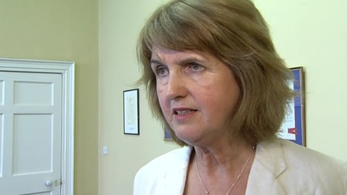 Joan Burton said over €1bn was being spent on allowances for one-parent families