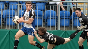 Sean Scanlon (l) scored Cork Con's only try in Donnybrook, but a two-try Man of the Match salvo from John Kennedy (pictured tackling) pushed Belvo to victory